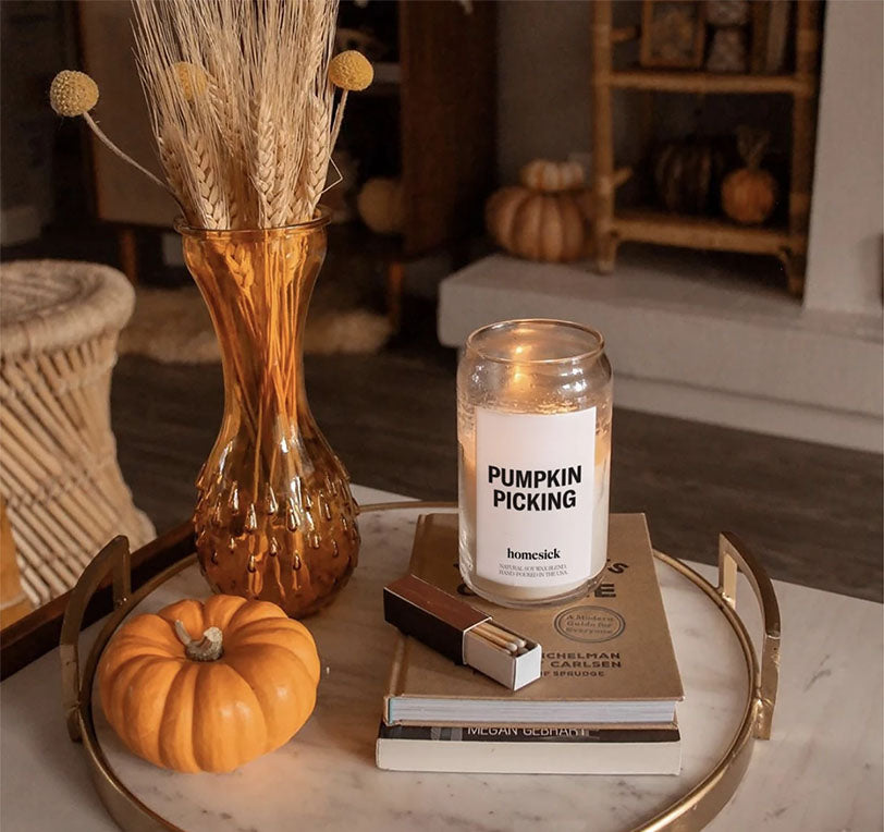 pumpkin picking candle on table