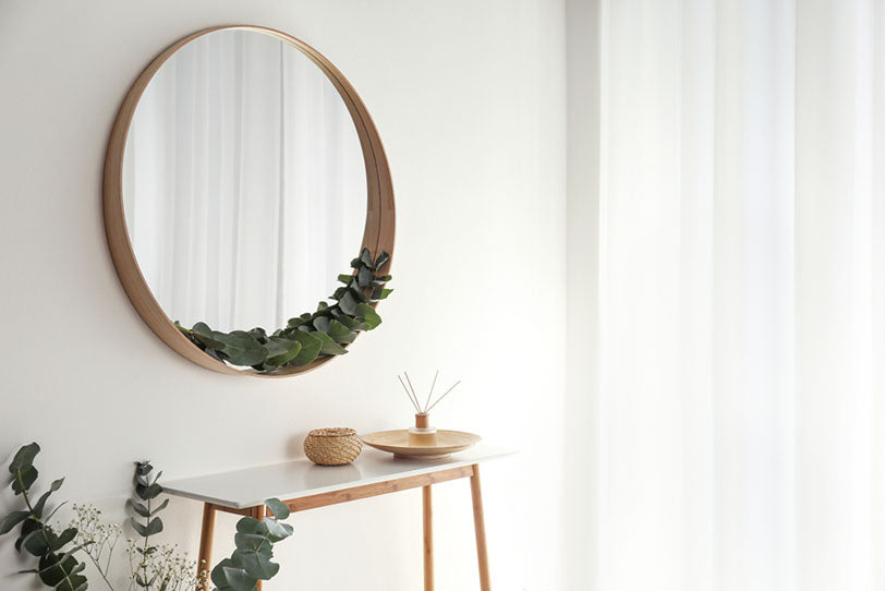 round mirror with a wooden frame
