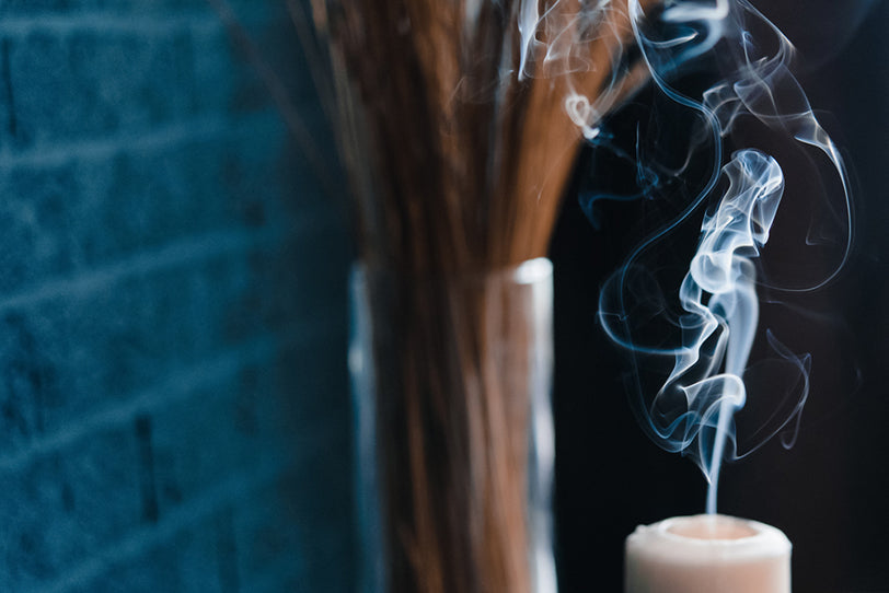 a picture of smoke flowing off an extinguished candle