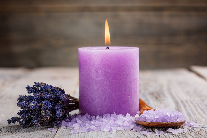 spa setting lavender salts and candle