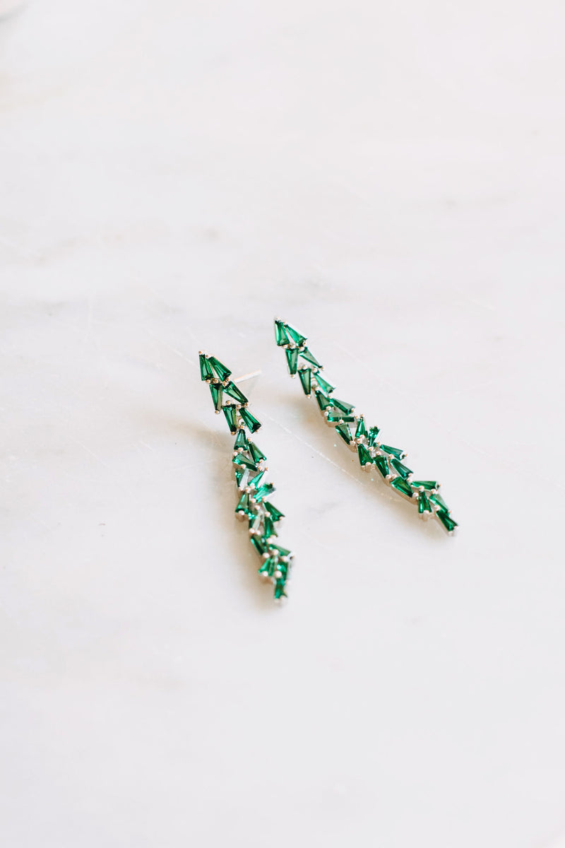 Styled image of our Aurora earrings placed on a marble bench.