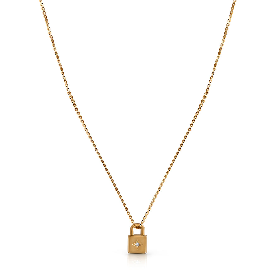 product image of fine gold chain with a small padlock pendant with a gemstone in the middle on a white background