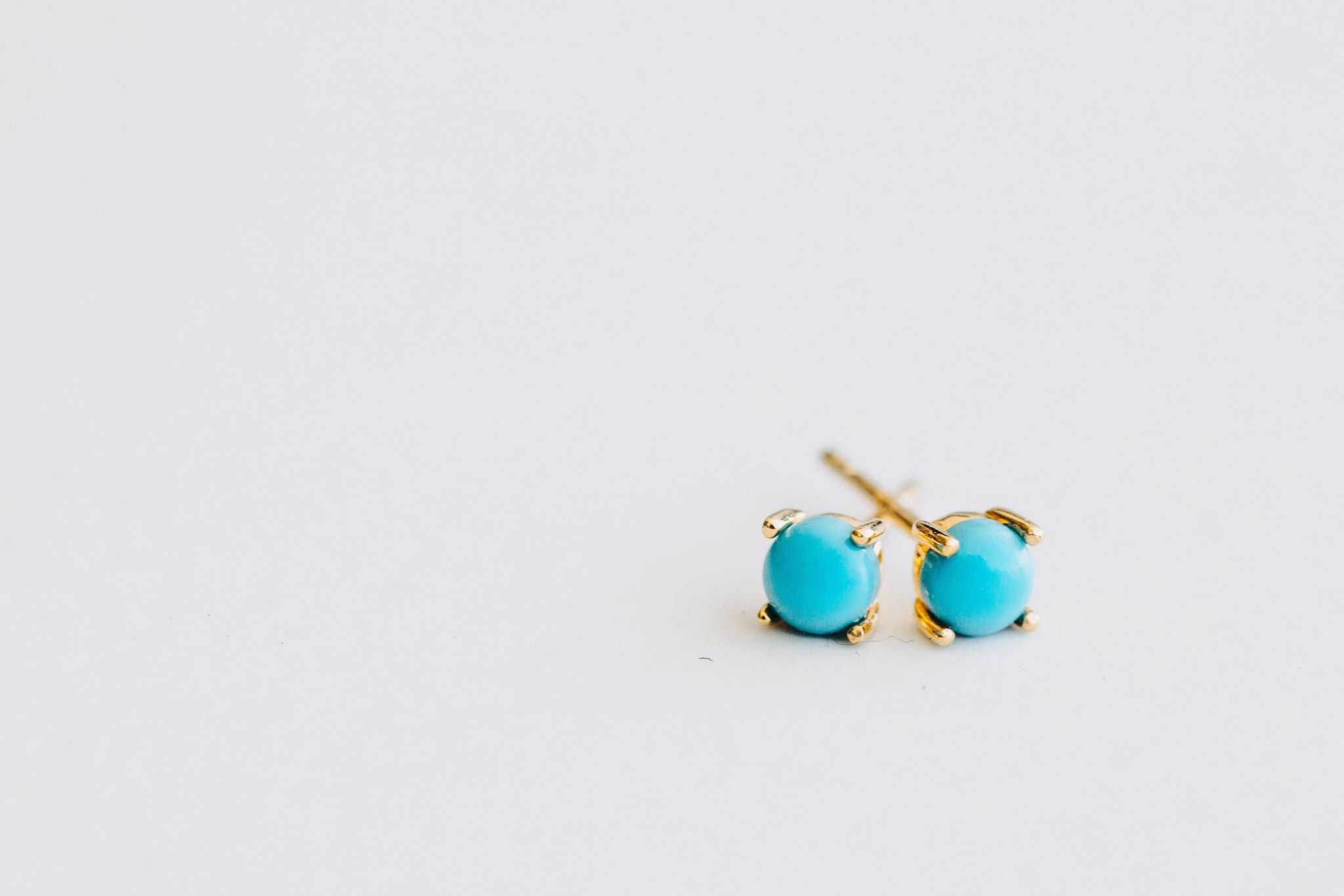 Castle rock turquoise stud earrings, sterling silver, yellow gold plated
