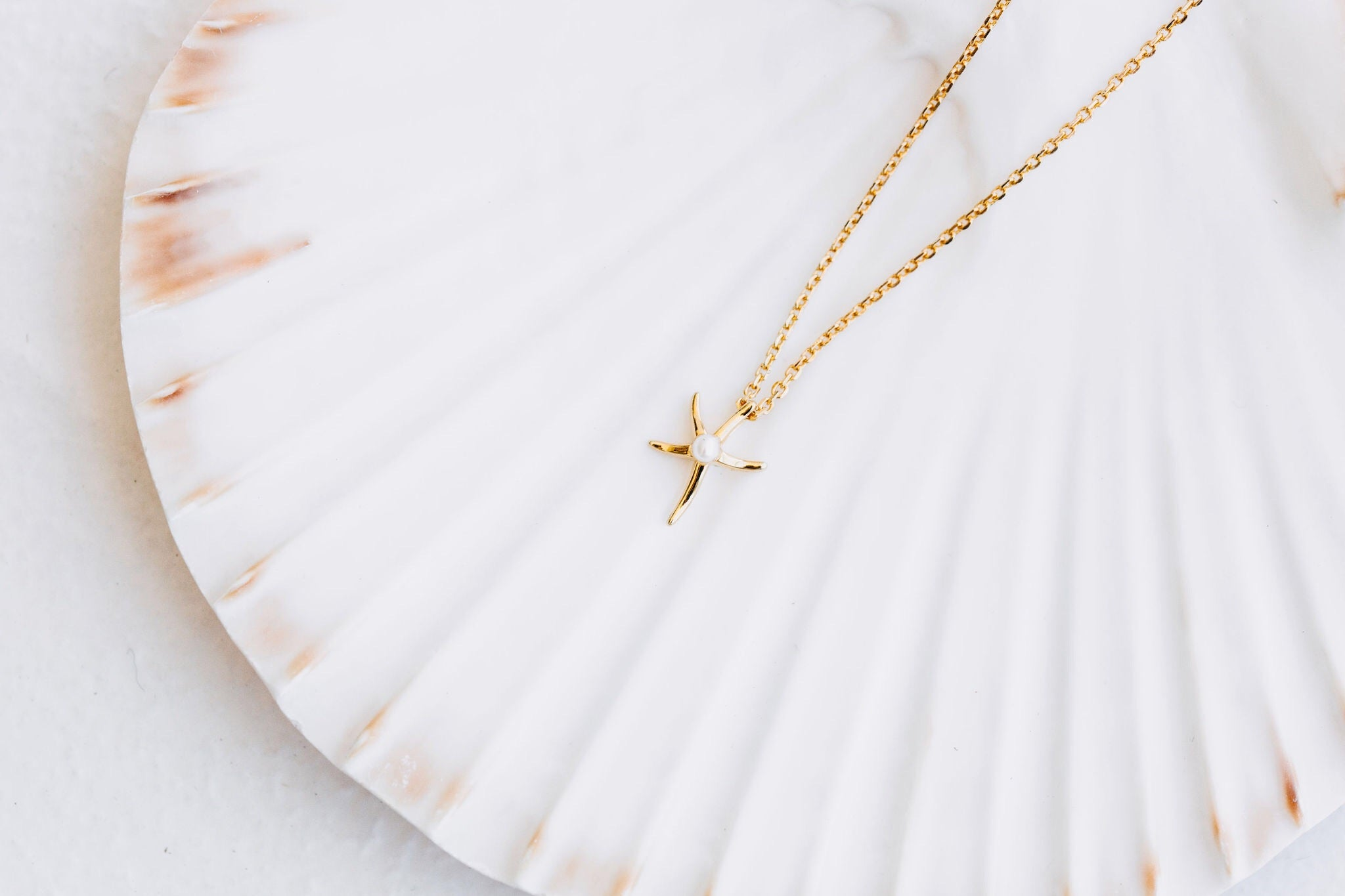 Ningaloo starfish necklace, sterling silver, yellow gold plated