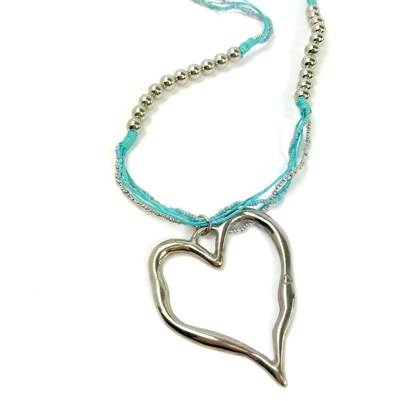 Heart pendant necklaces - silver pendant - beaded blue strand