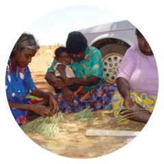 Aboriginal women making bush tucker