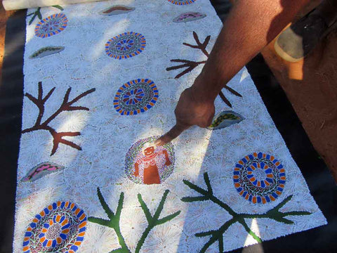 Katie Kemarre points to symbols in bush tucker painting