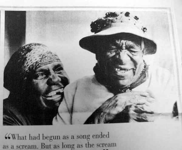 "Old newspaper article image of Gloria Petyarre and Emily Kame Kngwarreye laughing. Captioned ""What had begun as a song ended as a scream""."