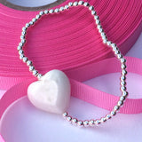 Sterling Silver Stretch/Elasticated Bracelet with Coral Heart
