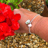 Sterling Silver Stretch Bracelet with Sterling Silver heart and large Freshwater Pearl