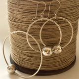 Sterling Silver Hoop Earrings with silver floating orbs, handmade