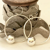 Large sterling silver hoop earrings with silver floating orbs, handmade