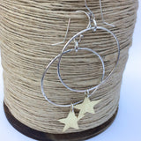 Large sterling silver hoop earrings with hammered golden brass stars, handmade
