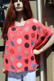 ladies gauzey cotton top with muted spots in coral