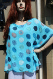 ladies gauzey cotton top with muted spots in turquoise
