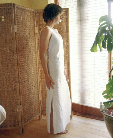 ladies white sleeveless linen dress with long side slits