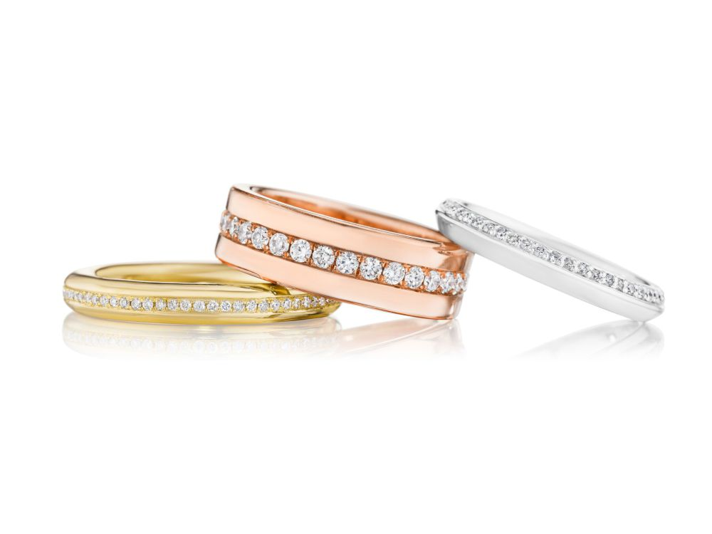 Staged shot of Omi Gold lab created diamond rings with white background
