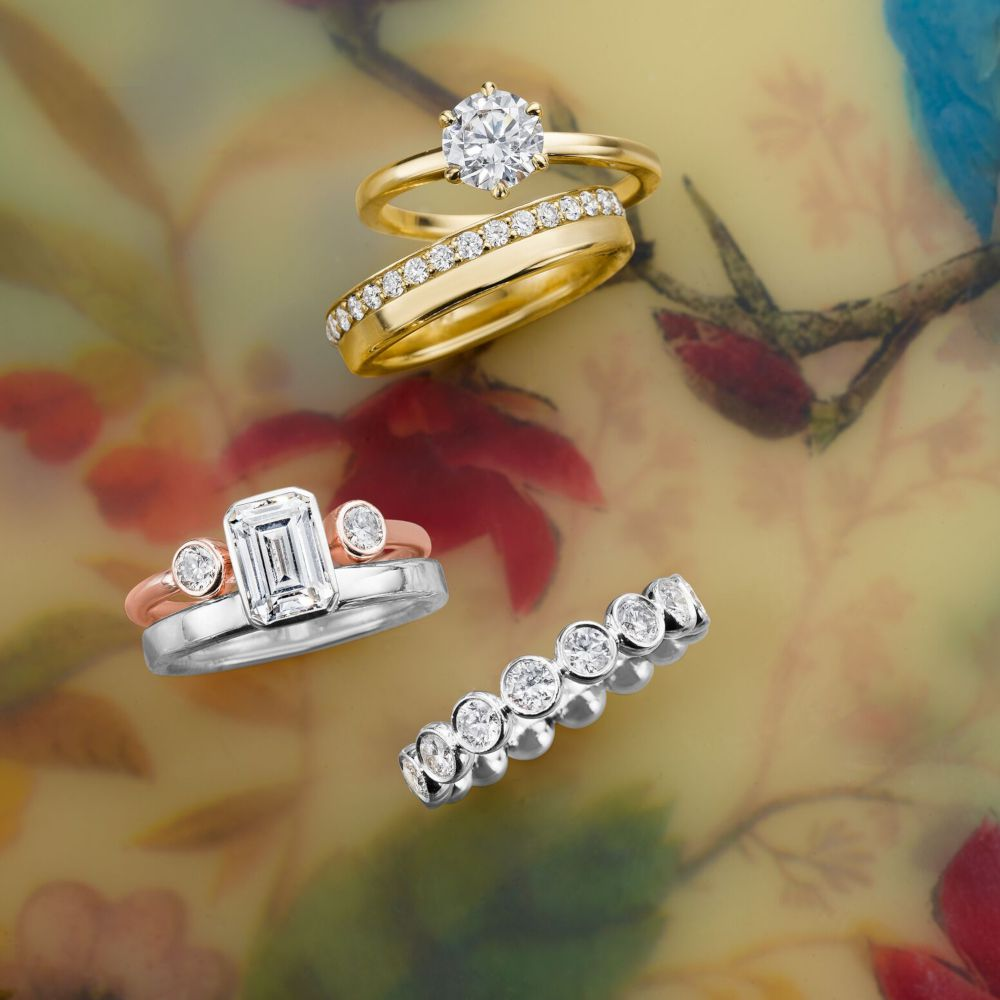 Man made diamond rings by Omi Gold arranged on floral background