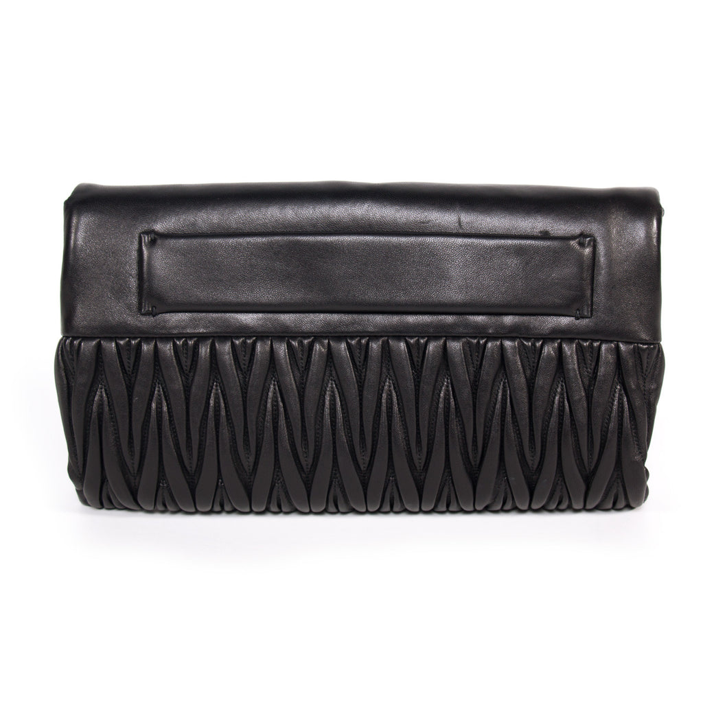 Miu Miu Matelassé Pochette Bags Miu Miu - Shop authentic new pre-owned designer brands online at Re-Vogue
