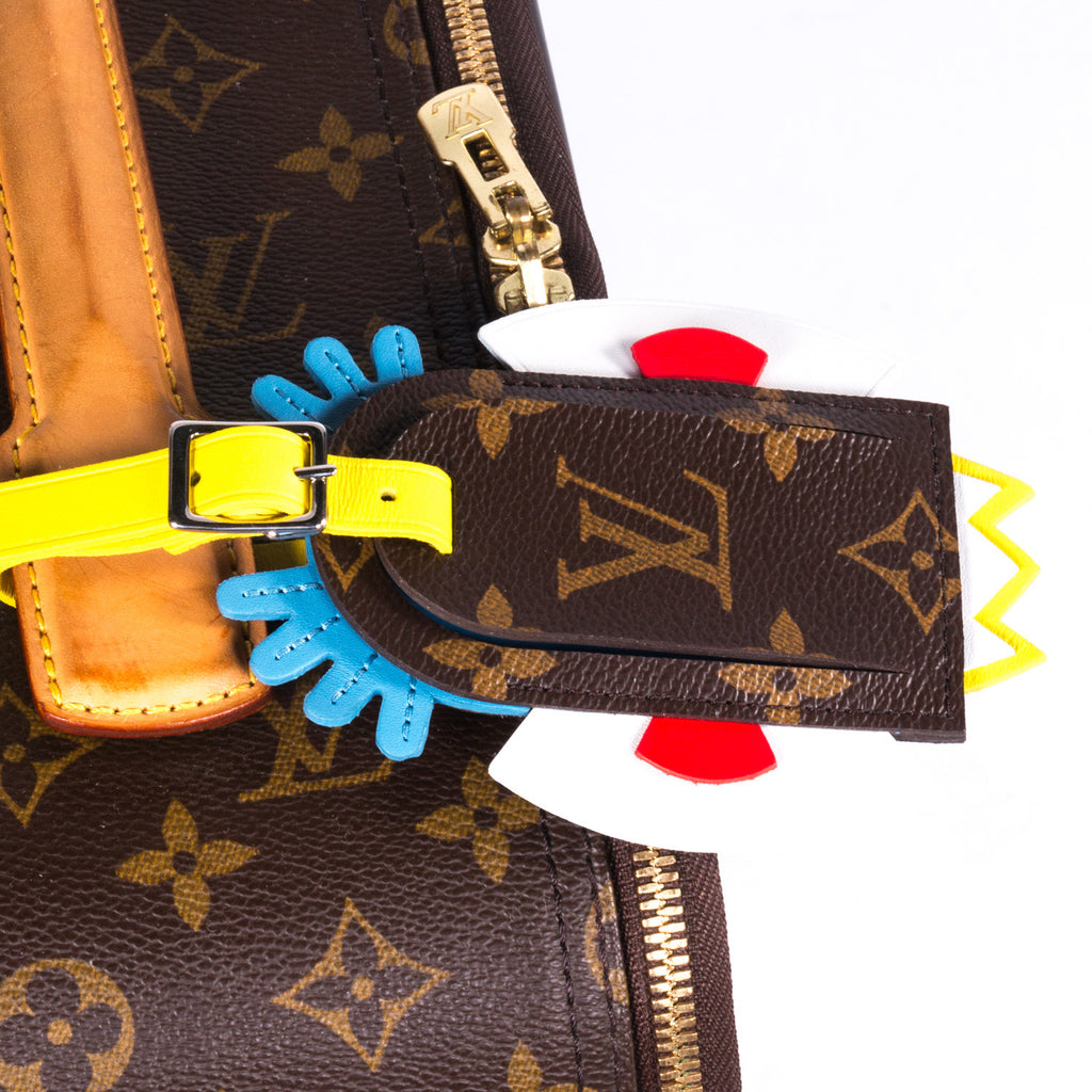 Louis Vuitton Tribal Mask Luggage Tag - revogue