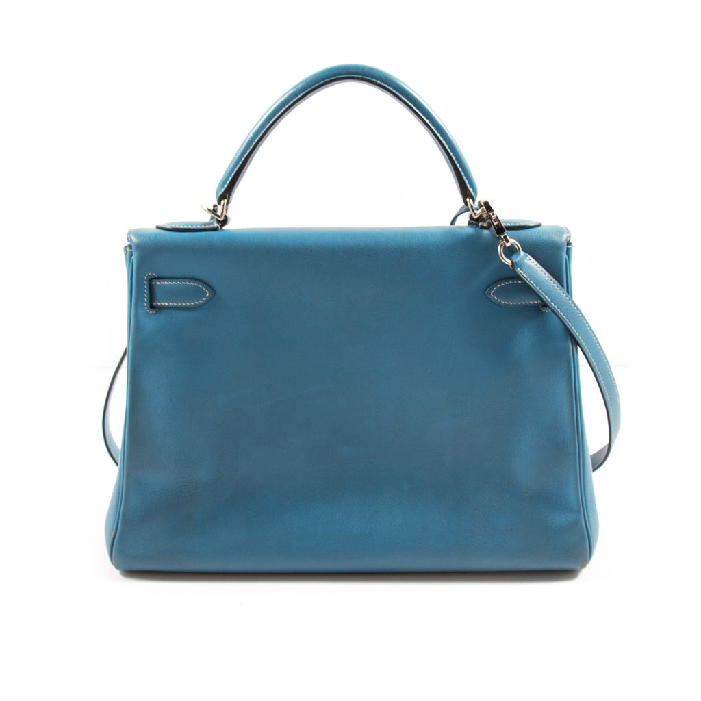 Hermès Kelly 32 Retourne Bleu Jean Swift Bags Hermès - Shop authentic new pre-owned designer brands online at Re-Vogue