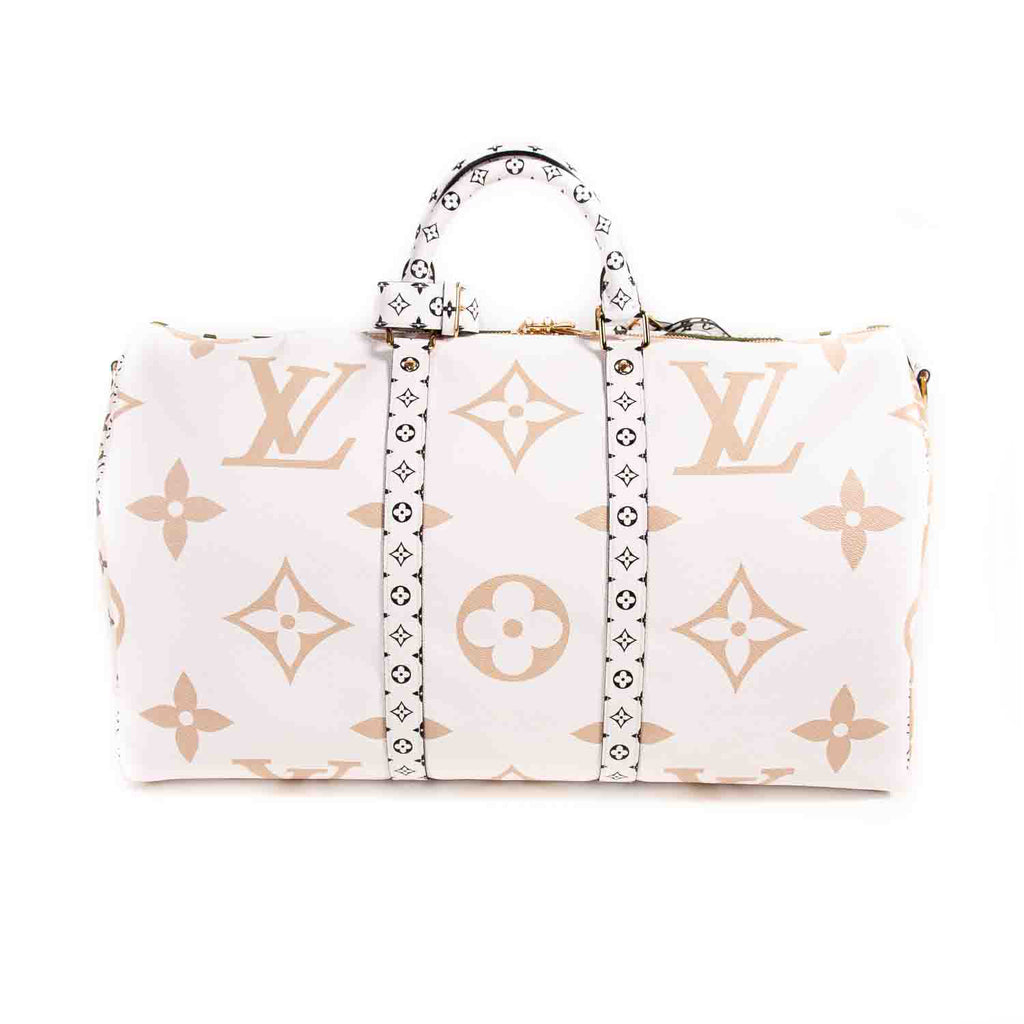 Louis Vuitton Monogram Giant Keepall Bandouliere 50 Bags Louis Vuitton - Shop authentic new pre-owned designer brands online at Re-Vogue