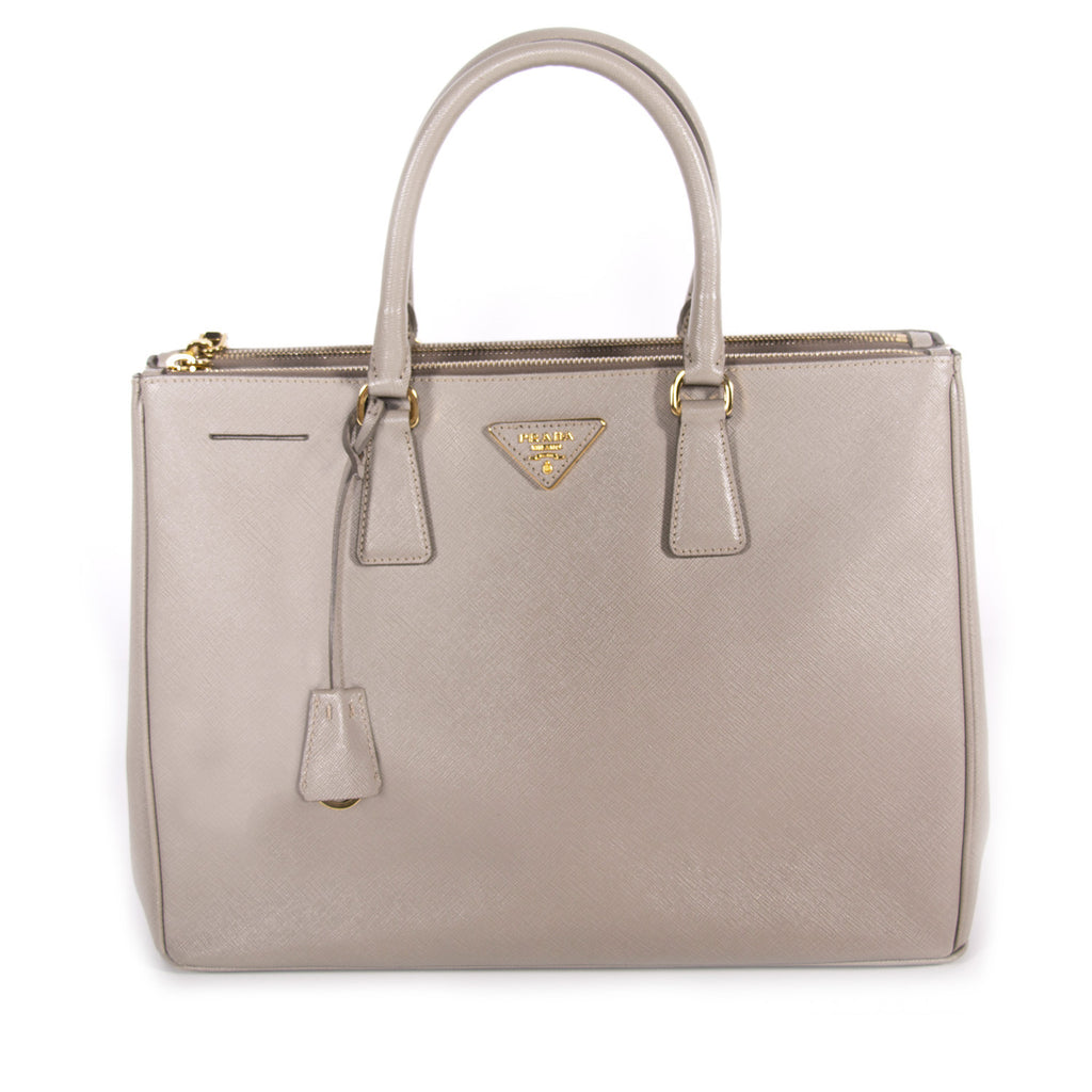 e5558c3b4c10 Shop authentic Prada Saffiano Double Zip Tote at revogue for just ...