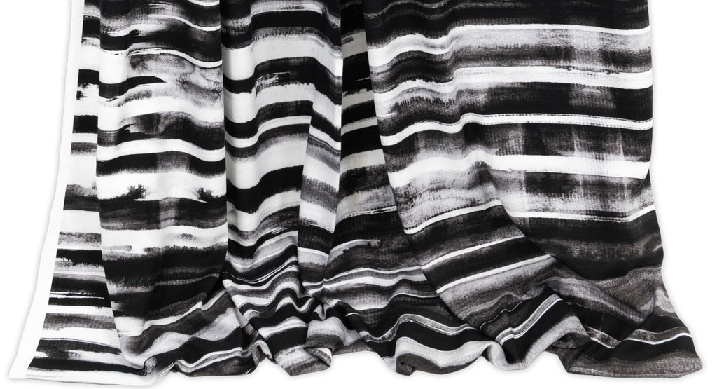 Designer striped fashion fabrics sold as yardage.