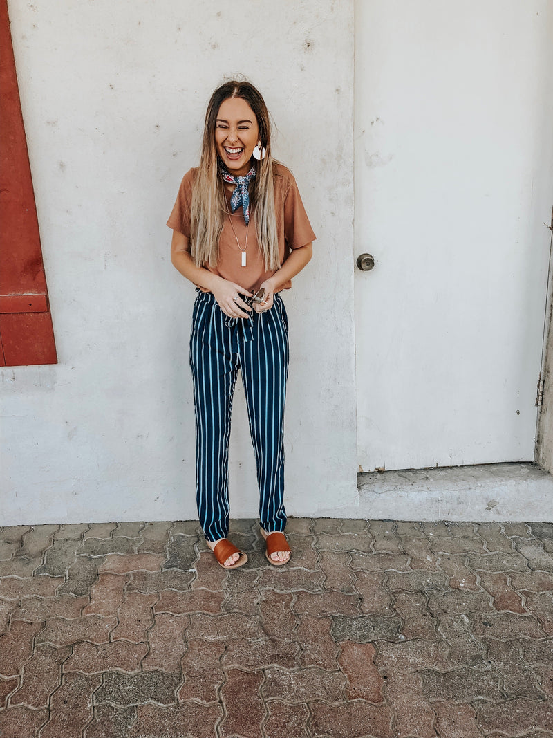 Comfortable, casual and absolutely adorable. There is so much to say about these pants! We are all a little obsessed over them! Perfect to dress up or keep casual.