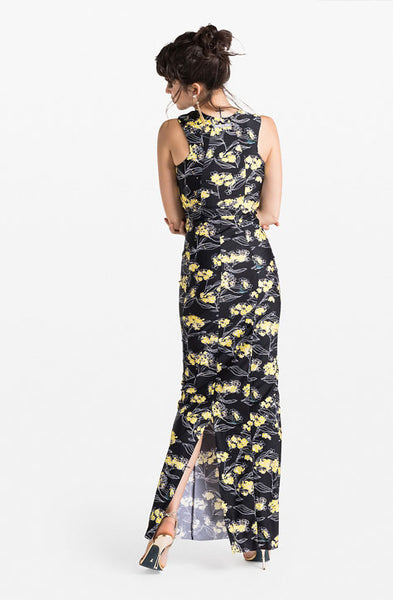Long Dress with  black yellow and white flower print all over. Patrizia Pepe available at our digital boutique Affairedefemmes.net