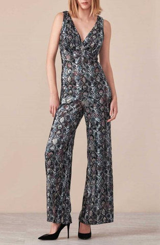 The LYRA is a snake print velvet jumpsuit with a deep front and back v-neckline and an empire waist that is fitted to the body with a flared pant leg. Anne Fontaine in-store Boutique Affairedefemmes.net