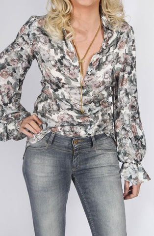 The LOAN is a floral printed viscose shirt featuring a pointed collar, a high-low hemline style and a concealed front button placket for closure. Anne Fontaine in-store Affairedefemmes.net