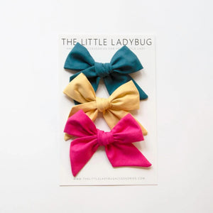 Set of Three Hand-Tied Fabric Bows in Peacock Blue, Buttercup Yellow, and Hot Pink