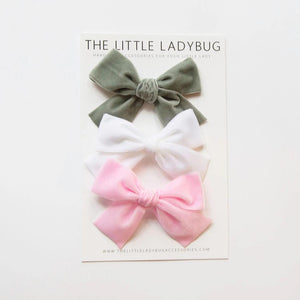 Set of Three Hand-Tied Velvet Bows in Gray, White, and Light Pink