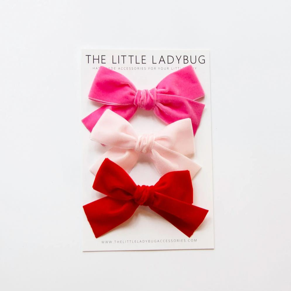 Set of Three Hand-Tied Velvet Bows in Shocking Pink, Baby Pink, and Bright Red