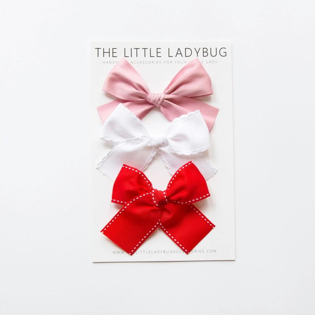 Set of Three Valentine's Ribbon Bows in Satin Pink, White Scallop, and Red Stitch