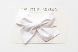Set of Three Hand-Tied Fabric Bows in Tan, White, and Peach