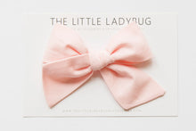 Set of Three Hand-Tied Fabric Bows in Black, Dark Gray, and Light Pink