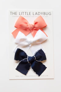 Set of Three Hand-Tied Ribbon Bows in Peach, White, and Navy Blue Scallop