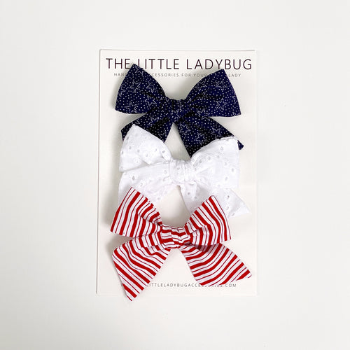 Set of Three Hand-Tied Fabric Bows in Ruby Red Stripes, Eyelet White and Navy Blue with Stars