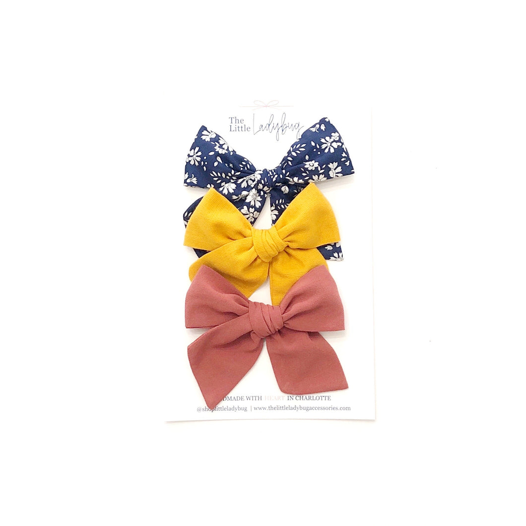 Set of Three Hand-Tied Fabric Bows in Liberty London Capel Navy, Butternut Yellow and Rosewood