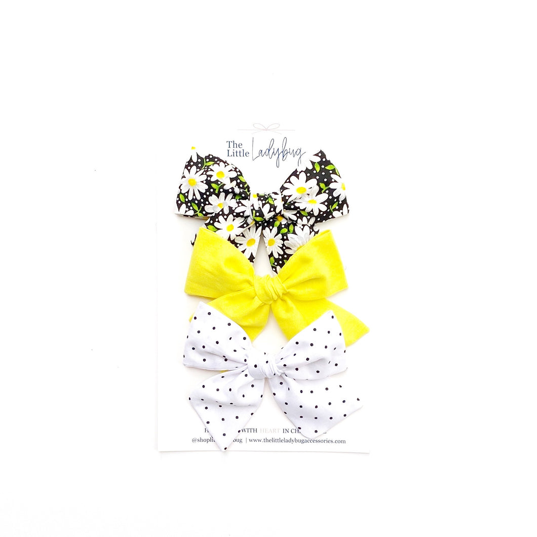 Set of Three Hand-Tied Fabric Bows in Black and White Daisies, Banana Yellow and Black Polka Dots