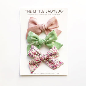 Set of Three Hand-Tied Fabric Bows in Blush Pink Linen, Pastel Green with White Floral and Orchid Fields