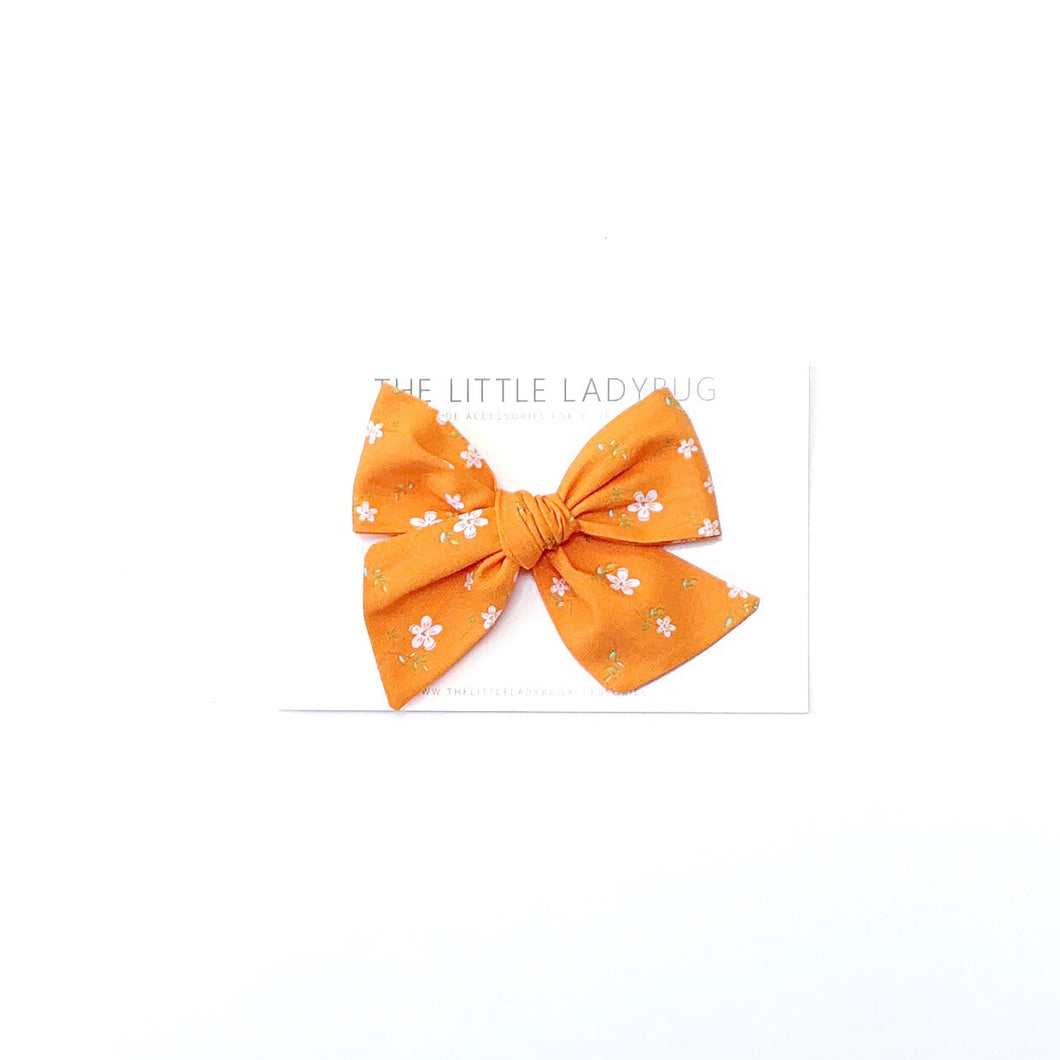 Orange with White Flowers Hand-Tied Fabric Bow