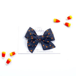 Set of Three Hand-Tied Fabric Bows in Black with Orange Stars, Witch's feet and Pumpkin Orange
