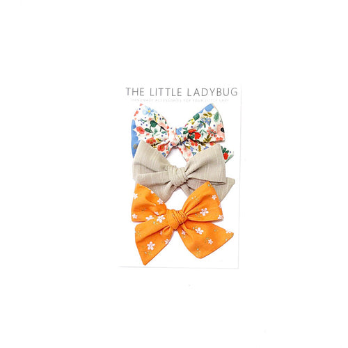 Set of Three Hand-Tied Fabric Bows in Summer Blue and Coral Floral, Khaki Linen and Orange with White Flowers
