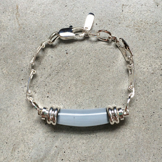 sterling silver bracelet with opaque glass pendant