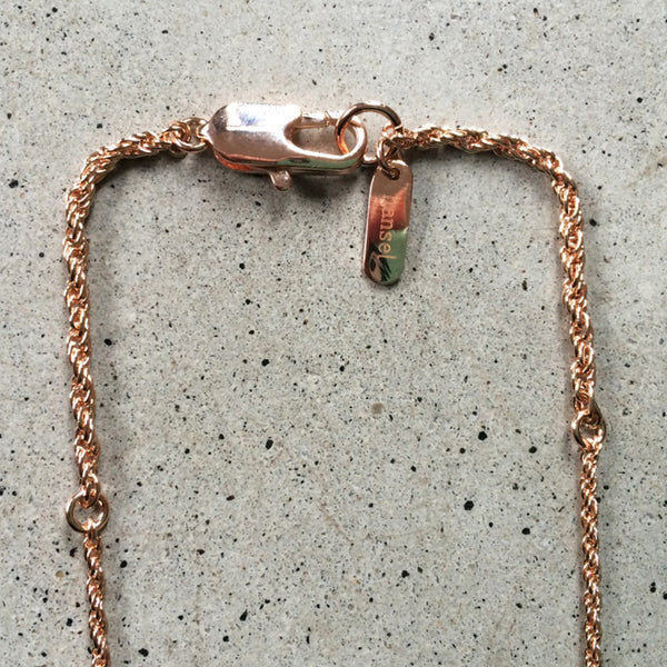 short rose gold necklace with turquoise stone inlay