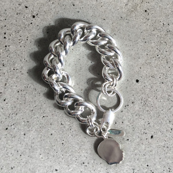 chunky silver bracelet with childs profile pendant