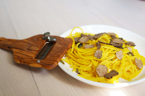 Saffron sauce with White Truffles (tuber magnatum pico) and Black Truffles shaving.